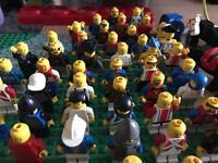 75 lego mini figures and 12 horses