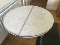 Lovely round fold up table