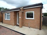 2 bedroom detached bungalow with garage in quiet private road close to town centre