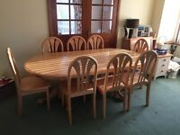Solid Pine dining room table and 8 chairs