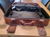 Old faux leather suitcases