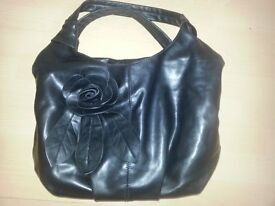 Ladies black bag with rose detail