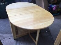 fold away pine table and 4 chairs