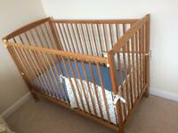 Dropside cot mattress and cot activity toy