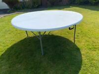 Round folding trestle table