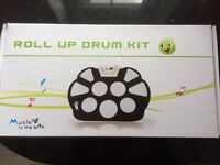 silicone based childs roll up drum kit.