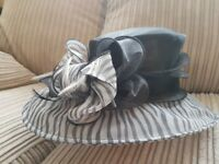 Black and grey plain and striped elegant hat. Worn once for Buckingham Palace Garden Party