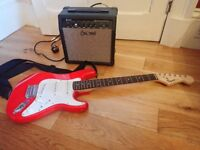 3/4 Fender Squier Stratocaster and Amp