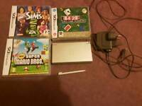 Grey Nintendo ds lite, includes charger and 3 games.