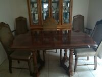6 seater dining room table and 6 chairs .