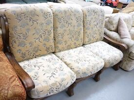 Three seater wooden framed sofa plus chair