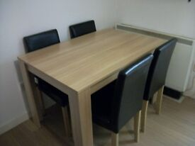 pinewood effect table and 4 chairs