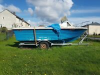 16 foot half cuddy boat with trailer