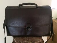Bag for a business lady, new, leather,dark brown colour .