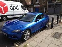 Awesome Mazda RX8 blue.