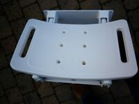 Fold-down shower seat. As new.