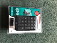 Cordless number pad for notebooks