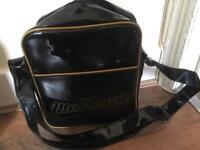 Mckenzie gold and black medium sized pouch