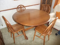 Circular drop leaf table and four wheelback chairs
