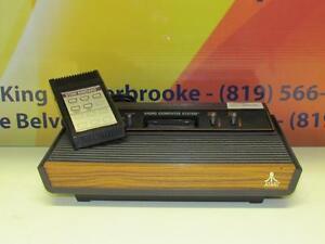 Console Atari - Instant Comptant -