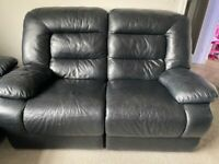 Black leather reclining sofas 2 seater and 3 seatee