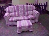 Fabric pattern 3 seater sofa and poufee Good condition Delivery Available