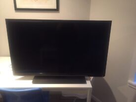 40 inch Toshiba LCD smart TV with stand. 3 HDMI ports and USB port