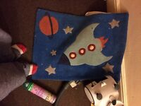 Space themed child's rug.