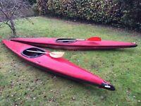 2 red fibreglass single canoes