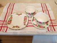 Bone china plates, cups, sugar and milk jug