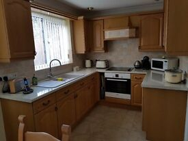 High quality kitchen units with worktops plus two sinks.