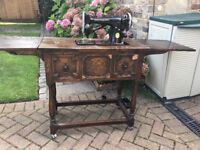 Beautiful old collectable Singer sewing machine and table with many many attachments and extras