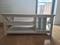 White coffee table with magazine rack
