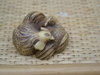 A NETSUKE IN THE FORM OF TWO CHICKENS
