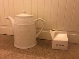 White ceramic teapot and small cream / milk jug