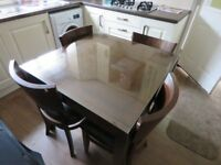 Extending table and four matching chairs