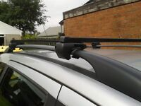 PAIR OF ROOF BARS WITH KEY ,FIT ONTO EXISTING ROOFRAILS FIT MOST MODELS
