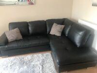Black leather corner sofa, cushions and footstool