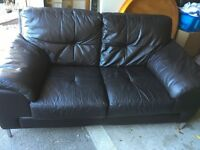 Brown leather sofa and swivel chair