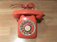 Old style retro landline telephone salmon pink colour