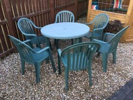 Green outdoor plastic table and 6 chairs