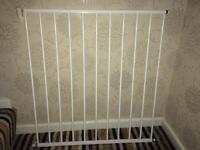 Two metal stair gates