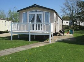 New 2017 3 bed caravan with patio doors and balcony for rent / hire at Craig Tara, close to complex