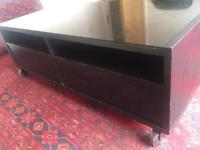 Sleek black rectangle large coffee table with glass top