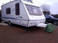 Immaculate 4 berth light weight new style swift caravan.