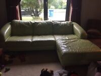 Green leather sofa and foot stool