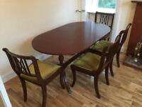 Dining Room Table and four chairs.