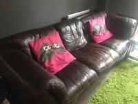 A well used brown leather sofa for sale