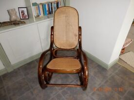 American style mahogany rocking chair with cane seating and back