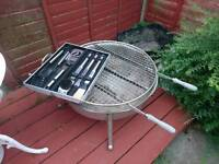 Custom made BBQ pit with tools